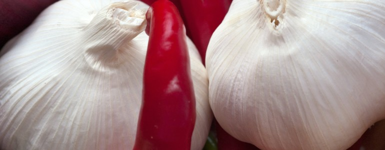 Two large bulbs of garlic and red peppers
